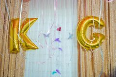 K and G For Best Friends Forever made of golden inflatable balloon letters . Word k and g written with helium golden balloons