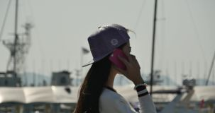 4k A girl using a smartphone at seaside,yacht & sailing in the harbour. Gh2_11088_4k stock video