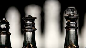 4K. Glass chess dynamic change of focus. Hand stock video footage