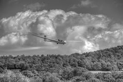 Glider landing in monochrome. K21 glider landing against a background of large cumulus clouds Stock Photography
