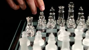 4K. Hand making a winning chess move  isolated on stock video footage
