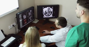 4K Healthcare, medical: Three Doctors In Hospital Examining CT Scan. stock footage