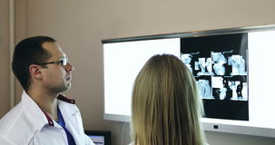 4K Healthcare, medical:. Two doctors discussing and looking x-ray picture in a clinic or hospital stock video footage