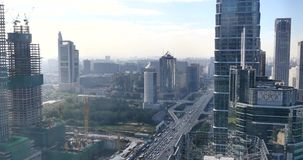 4k,heavy traffic through BeiJing central business district,urban building. 4k,Aerial View of heavy traffic through BeiJing central business district that is stock video footage