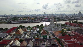 4K High angle view of Wat Arun temple and Chao Phraya river stock video footage