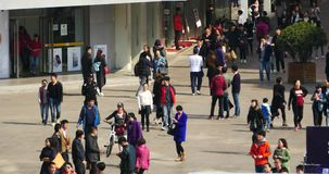 4k Huge Crowd Of People walking on china business street,QingDao,China. stock video footage