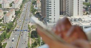 4k human using a smartphone aganist modern urban building background. Gh2_11400_4k stock video