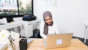 4K Hyperlapse time lapse of beautiful Asian muslim woman working using laptop in modern office. Small business company owner