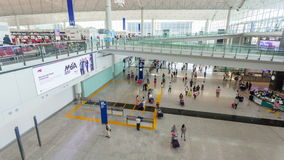 4k hyperlapse video of travellers in the arrival hall of Hong Kong International Airport. Hong Kong, China - June 12, 2015: 4k hyperlapse video of travellers in stock video footage