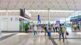 4k hyperlapse video of travellers in the departure hall of Hong Kong International Airport. Hong Kong, China - June 12, 2015: 4k hyperlapse video of travellers stock video