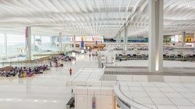 4k hyperlapse video of travellers in the departure hall of Hong Kong International Airport. Hong Kong, China - June 23, 2015: 4k hyperlapse video of travellers stock footage