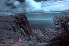 4K. InfraRed landscape: Movement of the clouds on the mountain bay Laspi. Crimea, Ukraine (TimeLapse) FULL HD Royalty Free Stock Images