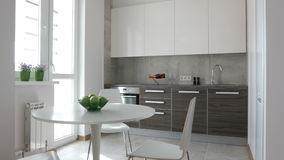 4K. Interior of modern kitchen in scandinavian style. Motion panoramic view stock video