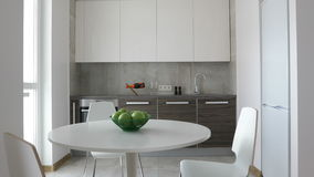 4K. Interior of modern kitchen in scandinavian style. Motion panoramic view stock video footage