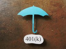 401k Investment. Paper umbrella over a 401k message royalty free stock image