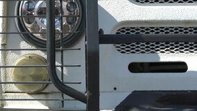 4k. The jeep`s headlight  close up