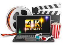4K laptop, popcorn and film strip. On a white background, 3d render Royalty Free Stock Photos