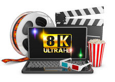 8K laptop, popcorn and film strip. On a white background, 3d render stock illustration