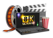 8K laptop, popcorn and film strip. On a white background, 3d render Stock Photos