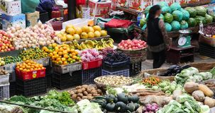 4k closeup variety of fruits in trade market,Shangri-La,china. 4k large outdoor fruits trade market in Shangri-La,china,minority women,variety of fruits in stock footage