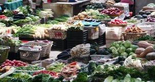 4k large outdoor vegetable trade market in Shangri-La,china,minority women,variety of vegetables & fruits. Gh2_10690_4k stock video footage