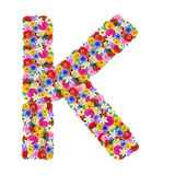 K,  letter of the alphabet in different flowers Royalty Free Stock Photos