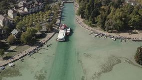 4K log Aerial view of Annecy lake waterfront low tide level due to the drought - France - Ungraded stock footage