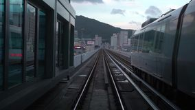 4K Looking out of window of a moving metro car train tracks in city of Busan stock footage