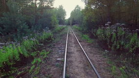4K. Low flight above narrow-gauge railway in the forest, aerial. stock footage