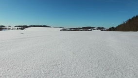 4K. Low flight and takeoff above snow fields in winter, aerial panoramic view. Winter land in the north.  stock footage