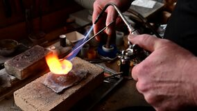 Jeweler melts gold in a liquid state in a crucible. Craft jewelery 4k resolution