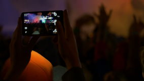 4K making video with cell phone at live music Royalty Free Stock Photo