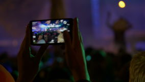 4K making video with cell phone at live music Royalty Free Stock Photography