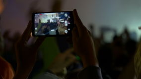4K making video with cell phone at live music Royalty Free Stock Image