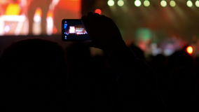 4K making video with cell phone at live music Stock Photos