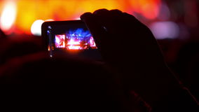 4K making video with cell phone at live music Royalty Free Stock Photos