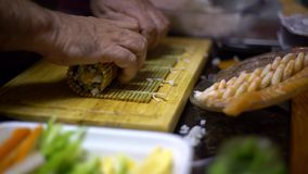 4K, Makizushi in preparation. Process of making homemade sushi and rolls. stock video footage
