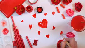 4K. Many hearts drawn on a paper. Red palette. Valentines or Mothers Day concept. stock footage