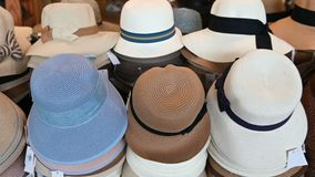 4K Many sun hats for sale at market stock video footage