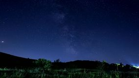 4K Milky way and stars timelapse over mountain background stock video