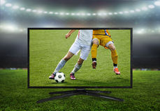 4k monitor isolated. Watching smart tv translation of football game Royalty Free Stock Photo