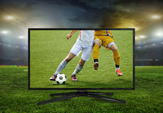 4k monitor isolated on white. Watching smart tv translation of football game Stock Image