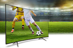 4k monitor watching smart tv translation of football game Stock Photography