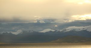 4k morning mist over lake namtso,tibet mansarovar,distant snow mountains. 4k morning mist over lake namtso,tibet mansarovar,distant snow mountains,Tibet's stock footage