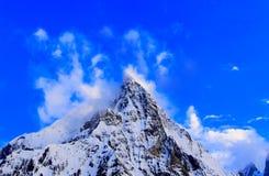 Broad peak near the K2 peak in the Karakorum mountains range in Pakistan. K2 mountain pakistan peak glacier landscape trekking summit snow blue camp karakorum royalty free stock photos