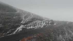 Mountain road in Georgia going to the pass in bad weather in fog and snow stock footage