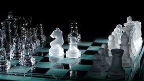 4K. Moving white chess  on glass chesboard stock video