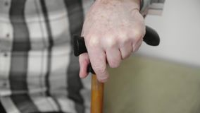 4k old elderly man with walking stick hard to stand up from the sofa, pernsion healthcare. Concept royalty free stock photos