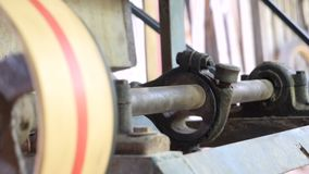 The old machine for agriculture working by the belt pulley and rotary gear spinning. 4K The old machine for agriculture working by the belt pulley and rotary stock video footage