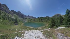4k Overview of blue alpine lake in the Italian Alps stock video